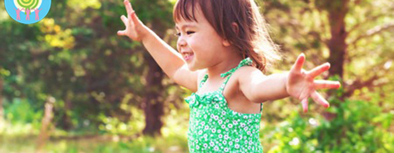 65011272 - happy smiling toddler girl playing outside
